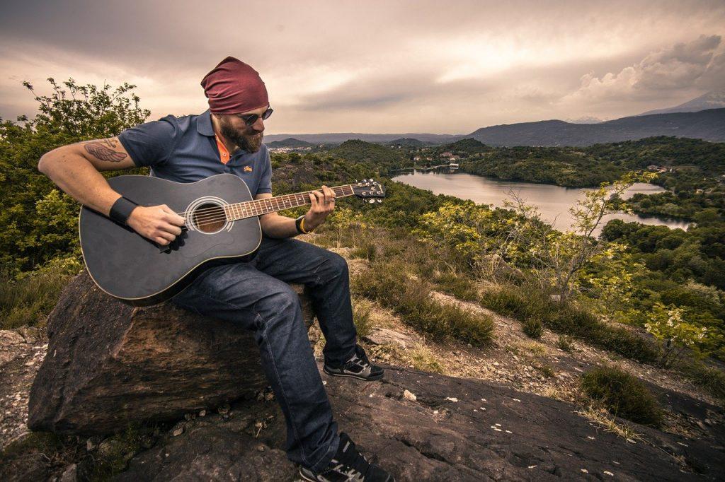 guitarist-acoustic-guitar-man-407212